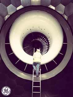 A #GE technician works on an engine inside the Turbulence Control Structure at an aviation facility in Peebles, OH.
