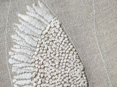 Bird Wing with French Knots and Satin stitch.