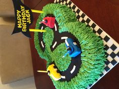 Race car themed birthday cake. Designed & decorated by The Pink Bakery Box.