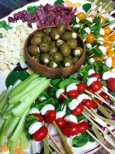 antipasto tray - love the tomato/mozzarella/basil skewers and the stuffed olives