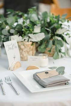 Slice small logs in half to serve as freestanding place-card and table-number holders | Brides.com