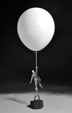 Work by French Photographer Gilbert Garcin ~ Icare contrecarré ~ going up, but tied down...