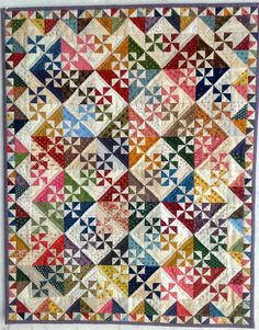 This divine miniature quilt was made by the very talented Leona Sweeney