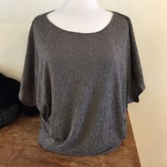 Top Dolman sleeve snakeskin top, more fitted on the bottom, perfect for casual or a night out Generation love  Tops