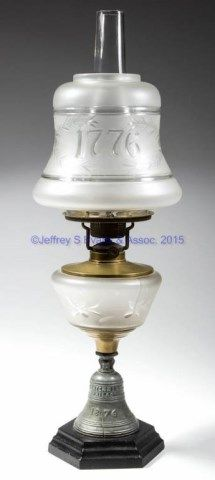 CENTENNIAL BELL FIGURAL STEM KEROSENE STAND LAMP,