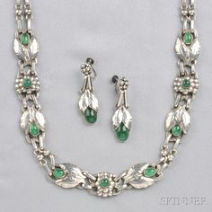 .830 Silver and Green Onyx Necklace and Earpendants, Georg Jensen, c. 1915-1919, designed by Georg Jensen, the bud and foliate motifs set with green onyx cabochons, lg. 14 7/8, 1 1/2 in., the necklace no. 1, the earpendants no. 23, each marked Georg Jensen and 830 in impressed oval, Denmark.