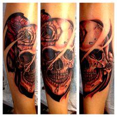 My shin tattoo gotta love my collection of skulls on my body