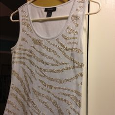 White and Gold studded tank Top White with gold studs tank top. Very versatile must have. Day or evening work or casual night out. No staining or beads missing. Size says Petite M, fits like a large though. Too big for me. I am a true medium in tops. Style & Co Tops Tank Tops