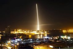 The first stage of the SpaceX Falcon 9 rocket returns to land in a time...