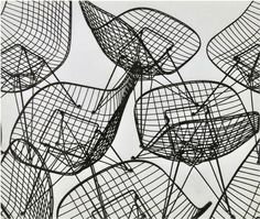 Charles Eames, Eiffel Tower Chair photograph, circa 1951. Silver Gelatin print. Presenting Charles and Ray Eames Wire chair, designed in 195...