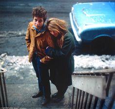 Photographers who added a bit of colour to the Big Apple: First non-black and white street photography of New York City goes on show. [Don Hunstein, Bob Dylan and his muse, artist Suze Rotolo, walk down West 4th Street in Greenwich Village, 1961].