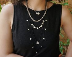 A unique set of three necklaces with multiple round and oval motifs, small round beads, black crystals and stainless steel chain. It's special and perfect for a fresh and modern look.  The two longer necklaces have its own macrame knot as closure for adjustable height and to mix & match them with Rock Jewelry, Evil Eye Necklace, Macrame Necklace, Short Necklace, Stainless Steel Chain, Black Crystals, Mix Match, Round Beads, Beautiful Necklaces