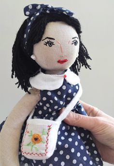 This one of a kind, handmade vintage inspired doll is named Jane. She is wearing a 1950s style polka dot dress with a white collar, red shoes and a white handbag with a vintage embroidered pocket...