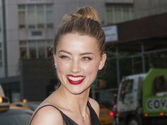Amber Heard : Chignon bohème et lèvres flamboyantes à New York