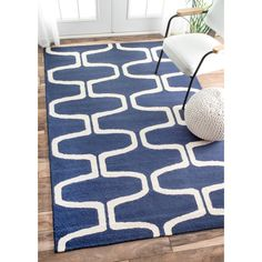 Bring style and elegance into your home with this rug. This rug is handmade with 100% wool and features a durable and plush pile suitable for high traffic areas.