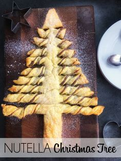 This Nutella Christmas Tree Pull-Apart is ridiculously easy to make, and can be made to work for you if you have any food allergies . Christmas Apps, Christmas Bread, Christmas Trees For Kids, Christmas Biscuits, Christmas Breakfast, Christmas Sweets, Christmas Cooking, Christmas Activities, Holiday Treats