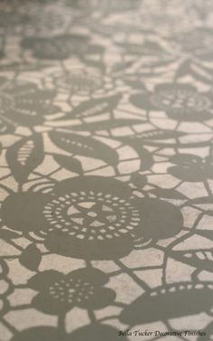 Painted concrete floor Skylar's Lace stencil painted by Bella Tucker Decorative Finishes
