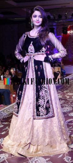 http://www.kalkifashion.com/ Alia Bhatt walks the ramp wearing a golden lehenga and blue long jacket for designer Kavita and Meenu at Khwab Fashion Show 2013