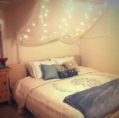 Keep the Glow Going: Twinkle Lights Year-Round - A beautiful light canopy makes a cozy place to go to bed, from boho girl.