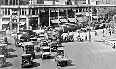 1921. Columbus Circle North. Busy street scene here with cars, trolleys, pedestrians and stores. theoldmotor.com