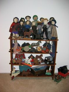 Amish toy and doll collection.An amish doll has no face details on  it.