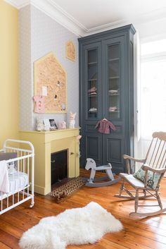 Gorgeous remodelled yellow and grey kids room in antique French home