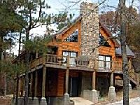 Dancing Rabbit Lodge - A four bedroom, three and a half bath cabin located in the prestigious Southern Hills Addition. It has a game ...