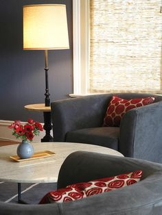 Love the slate grey with red accents. Could swith pillows for mustard yellow or navy blue, depending on the mood.