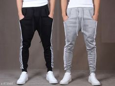 Track Pants Men's Casual Solid Track Pant (Pack Of 2) Fabric: Spun Blend Waist Size: S - 28 in M - 30 in L - 32 in XL - 34 in XXL - 36 in Length: Up to 38 in Type: Stitched Description: It Has 2 Piece Of Men's Track Pants  Pattern: Solid Country of Origin: India Sizes Available: S, M, L, XL, XXL *Proof of Safe Delivery! Click to know on Safety Standards of Delivery Partners- https://ltl.sh/y_nZrAV3  Catalog Rating: ★3.9 (14153)  Catalog Name: Mens Casual Solid Track Pants Vol 5 CatalogID_115274 C69-SC1214 Code: 284-973565-