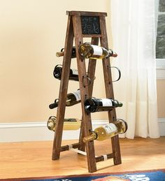 Wine rack from repurposed ladder (I like this because the wine is properly tilted to keep the cork wet [which it should be] but I want to combine the last wine rack I pinned with this one!)