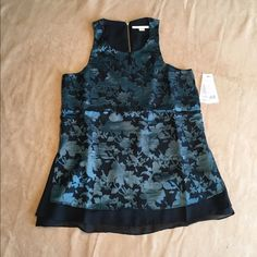 Cooper & Ella sleeveless blouse. Gorgeous Cooper & Ella sleeveless blouse. Black w teal floral print. Zipper at back neckline. Cooper & Ella Tops Blouses