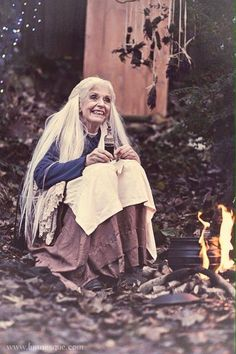 Beautiful Crone cooking up some more flying ointment.