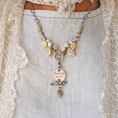 ❥ Tender Wish Woodland Necklace...love the way the strands on either side of the pendant are done
