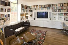 Another approach ... bookshelves around windows // TV on side wall