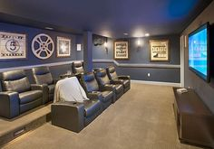 Say goodbye to sticky floors, trash, and gum on the seats. This #hometheater actually looks affordable – as far as home theaters go. #homefeatures #movienight