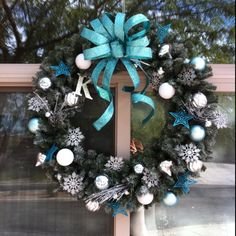 Homemade wreath. Flocked and then added decorations with green wire.