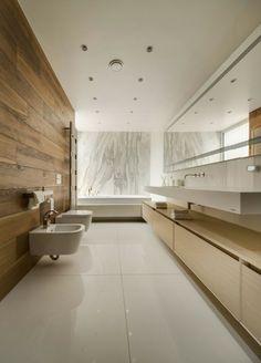 baño moderno al estilo minimalista con mármol y madera …