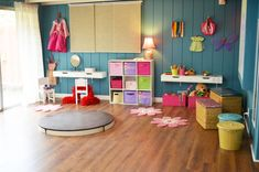 Little girls dress up section with free range circle stage. Love the custom storage bins and desks/vanity attached directly to the wall.