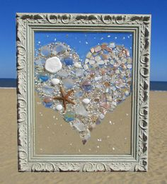 Unique beach window art by Luminosities! Shell heart piece complete with pink & green gems, sea glass, starfish and sand dollar.