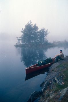 foggy morning by the lake with a canoe, love the trees