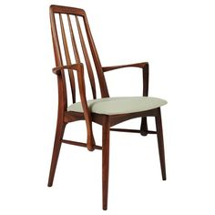 Niels Kofoed Rosewood Dining Chair with Arms, circa 1964 | From a unique collection of antique and modern dining room chairs at https://www.1stdibs.com/furniture/seating/dining-room-chairs/