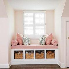Image from https://cdn.decorpad.com/photos/2015/06/27/m_pink-kids-window-seat-nook-built-in-bench-cubbies-dusty-pink-pillows.jpg.