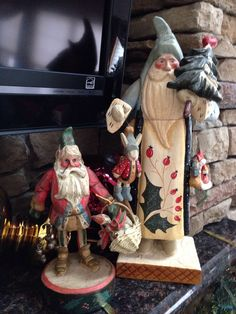"""House of Hatten Santas. The one on the left is """"The Enchanted Forest"""" 1988 figurine by Denise Calla. The 11"""" Santa Elf is holding a basket with a goose in it."""