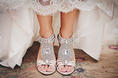 Lauren wore ivory sandals encrusted with crystal jewels and silver beads. Photo by Diana Deaver Weddings