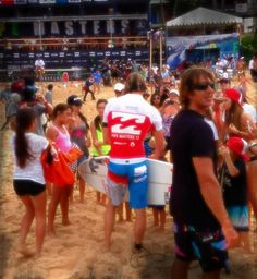 Dane Reynolds (USA) is greeted by his fans after winning his Round 1 heat. — at Pipeline, North Shore Oahu, Hawaii.