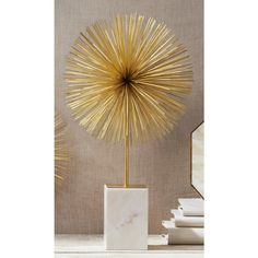 I found this on www.burkedecor.com; Starburst Statue by Twos Company