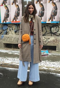 Gucci handbags, Acne shoes and flares = Berlin Fashion Week street style gold
