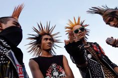 Burma Punks: The Colorful Youth of Rangoon  Young men attend a punk show during the water festival at a music bar in Rangoon in 2012.