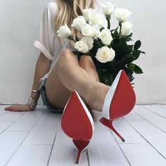 """Yesterday.  New shoes, fresh roses. What better way to start of the week. ❤️ Special order #LouboutinPigalleFollies120mm."""