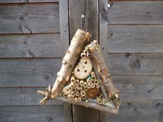 Little bug hotels to do with kids on fun days etc Then hang about in the trees. Perhaps a fundraising event?
